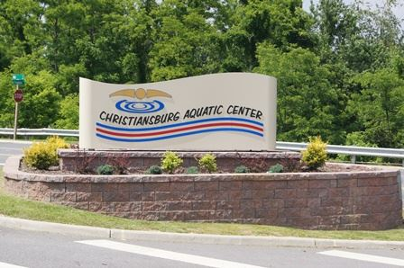 "A large sign which reads, ""Christiansburg Aquatic Center."""