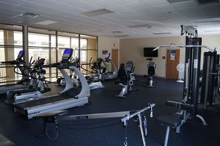 A large cardio room equipped with exercise machines.